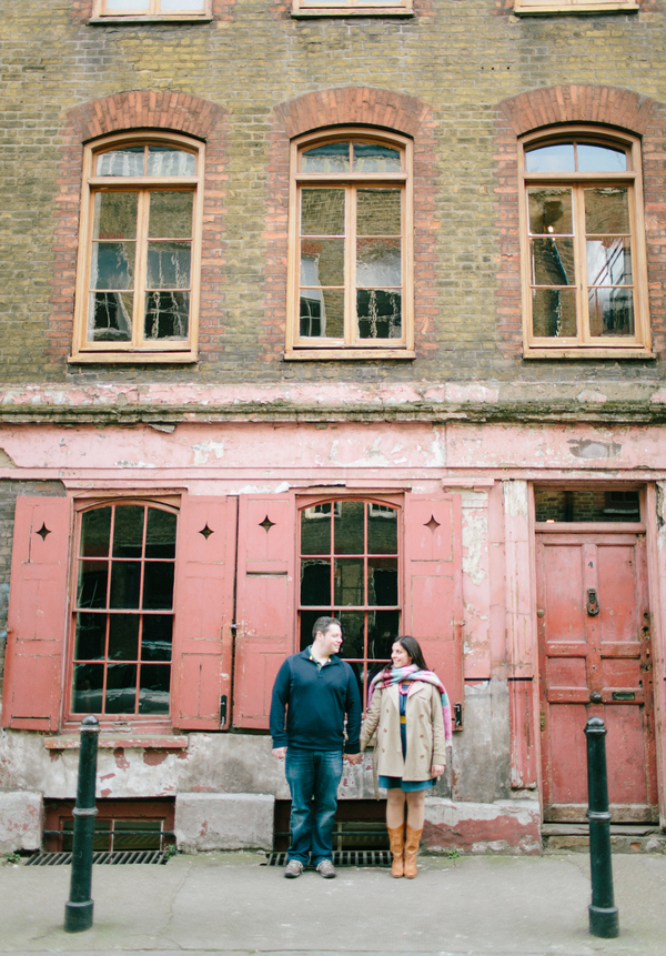 Couple in front of red front building in Shoreditch