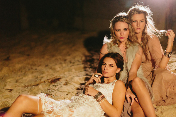 Bohemian bridesmaids on beach at night