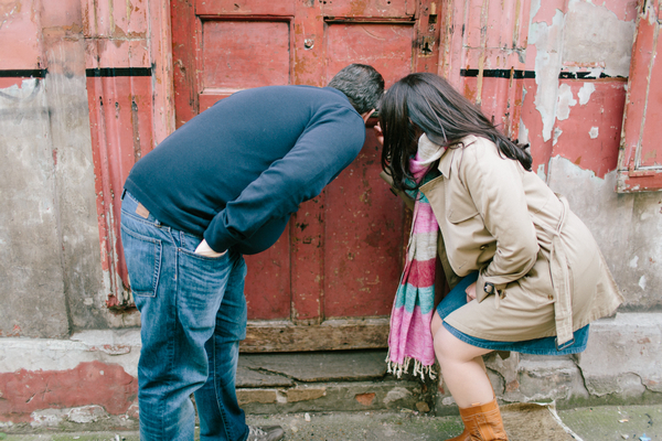 Couple looking through letterbox