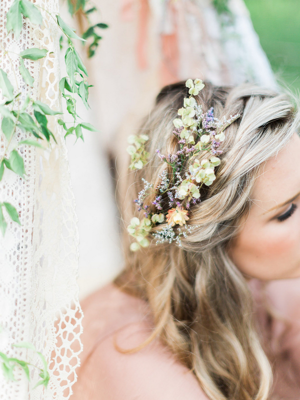 Flowers in bohemian bridesmaid's hair