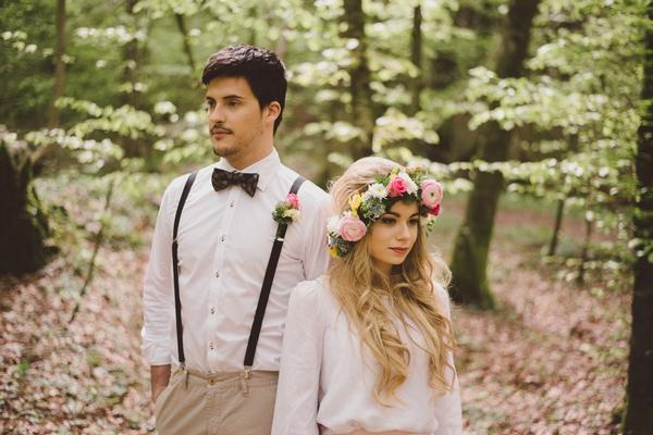 Boho bride and groom in woods