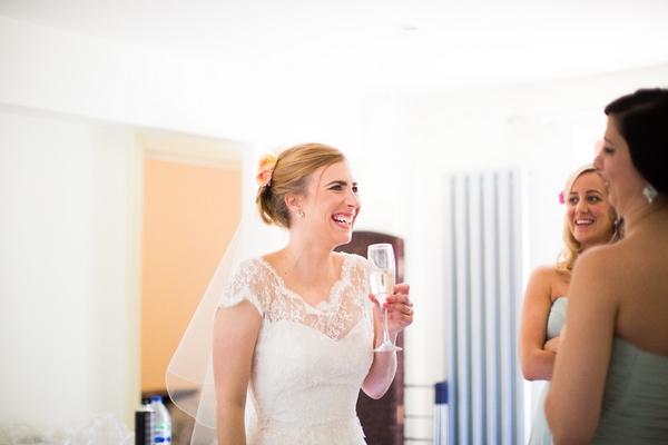 Bride drinking champagne