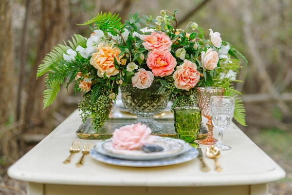 Wedding table setting with large floral centrepiece