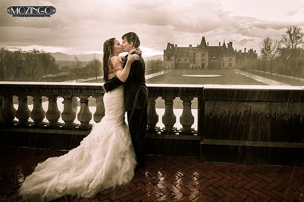 Bride and groom kissing in heavy rain - Picture by Mozingo Photography
