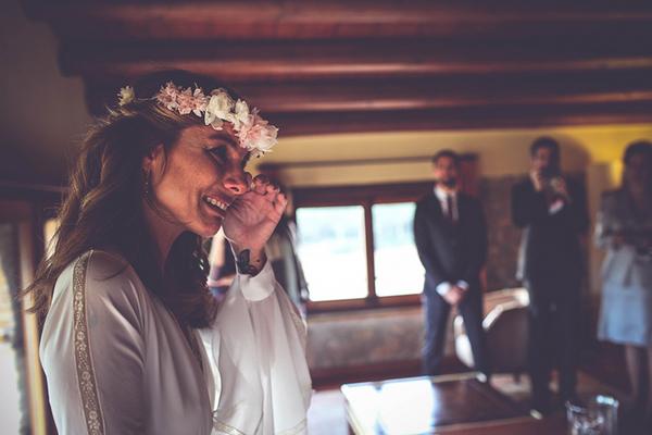 Bride wiping away tear
