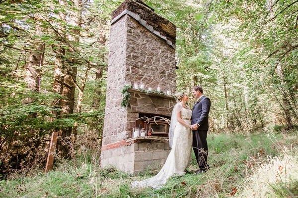 Bride and groom by stone structure