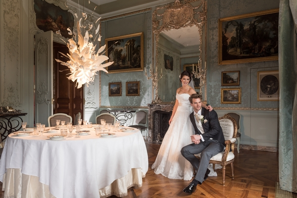 Bride and groom sitting in Blue Room at Waddesdon Manor
