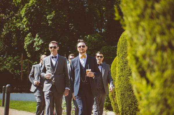 Groomsmen walking with pints