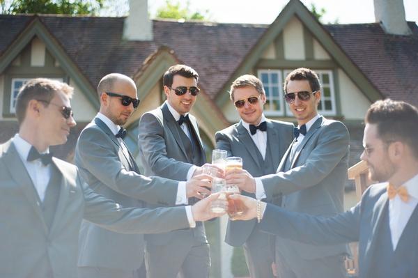 Groomsmen raising toast
