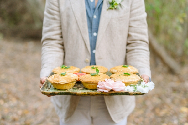 Groom holding tray of pies
