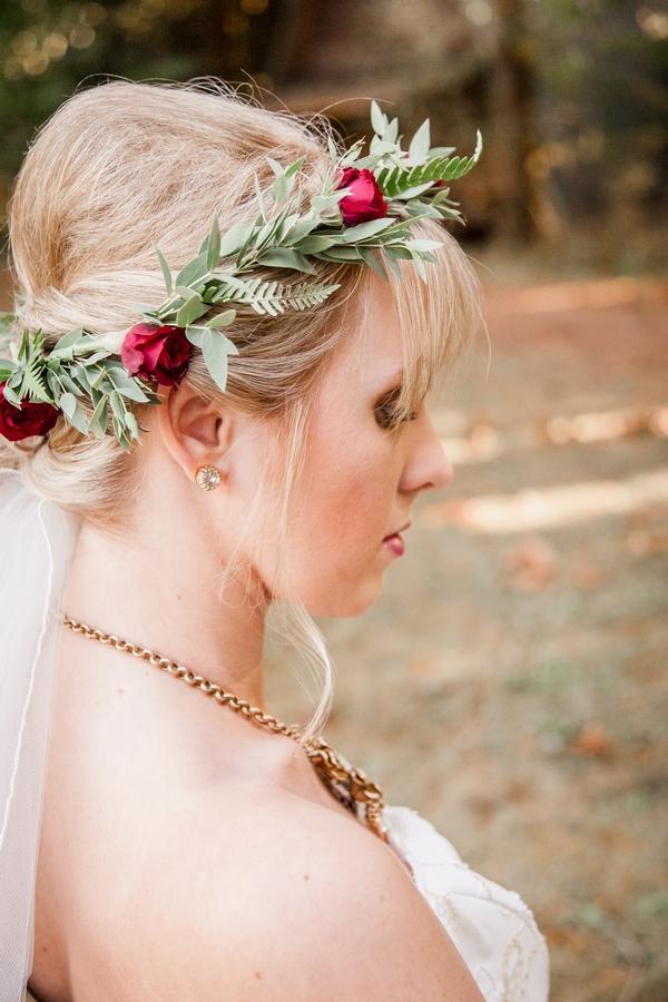 Bride wearing flower and leaf crown