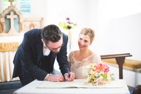 Groom signing register