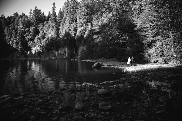 Bride and groom on other side of lake