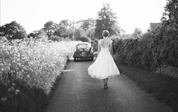 Bride walking down country lane