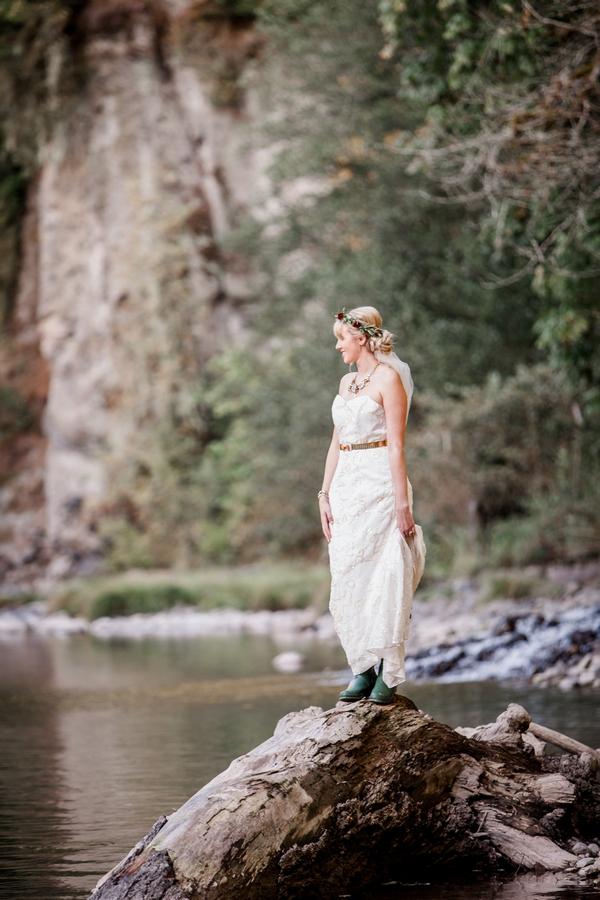Bride standing on rock