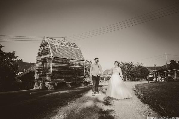 Bride and groom walking through Huntstile Organic Farm