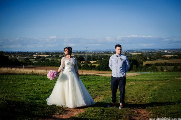 Bride and groom in field at Huntstile Organic Farm
