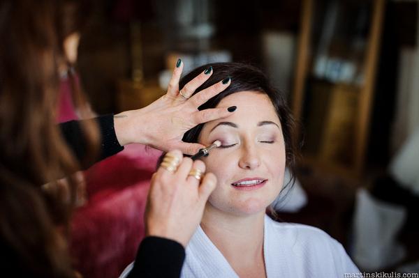 Bride having eye make-up done