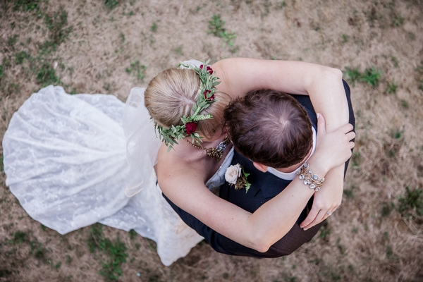 Picture taken above bride and groom kissing