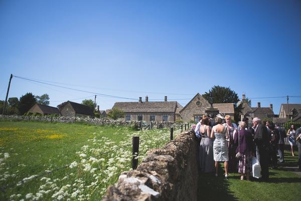 Wedding guests in field