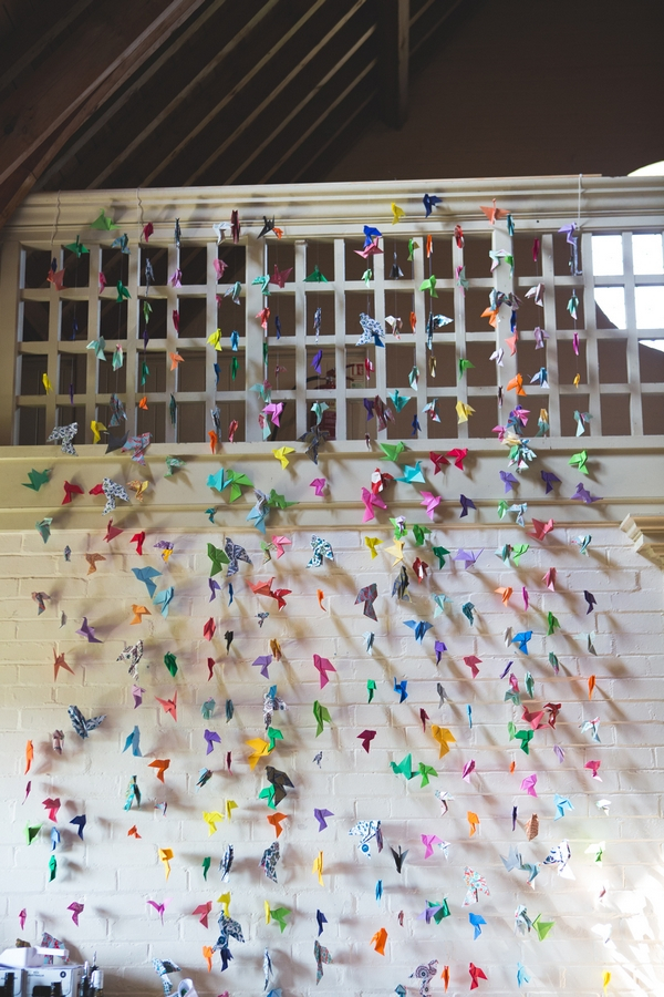 Wall of coloured paper cranes