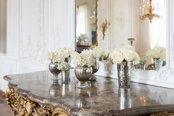 Wedding flowers in silver vases