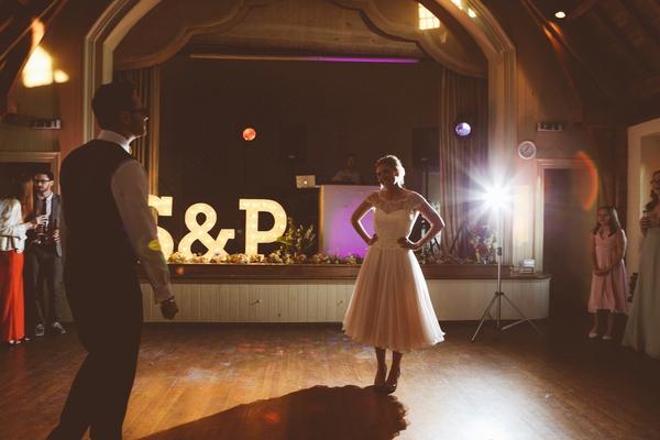 Bride with hands on hips on dance floor