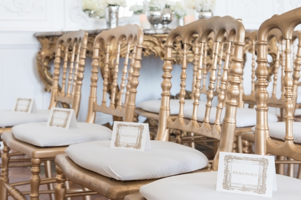 Name cards on elegant wedding chairs