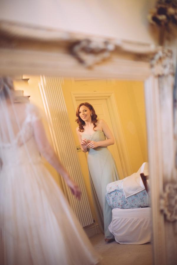 Bridesmaid reflected in mirror