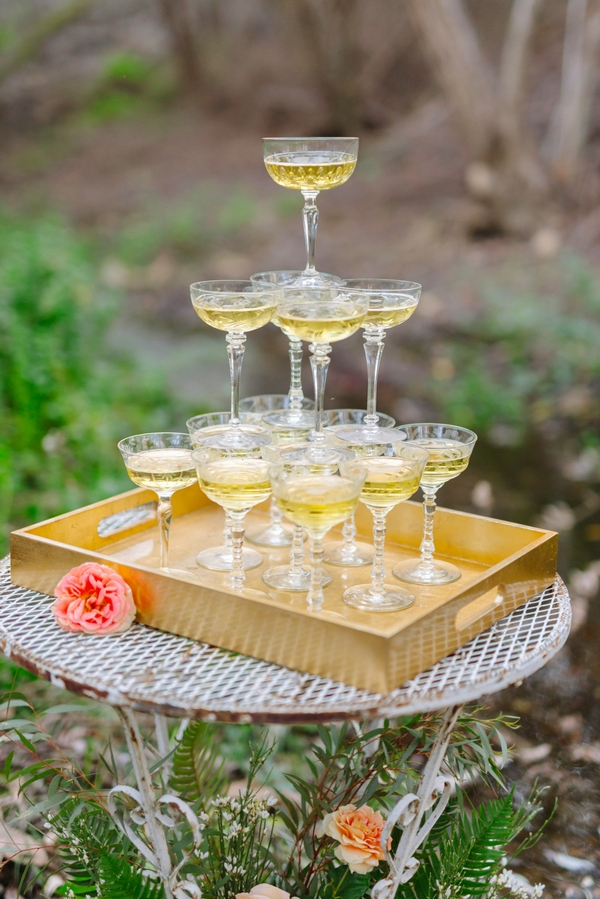 Tower of champagne glasses on tray
