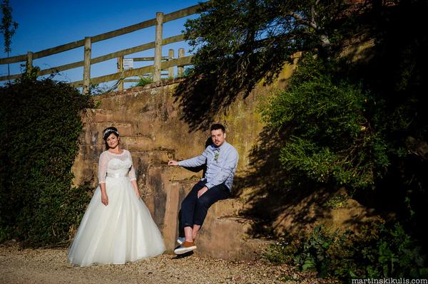 Bride and groom sitting on steps at Huntstile Organic Farm