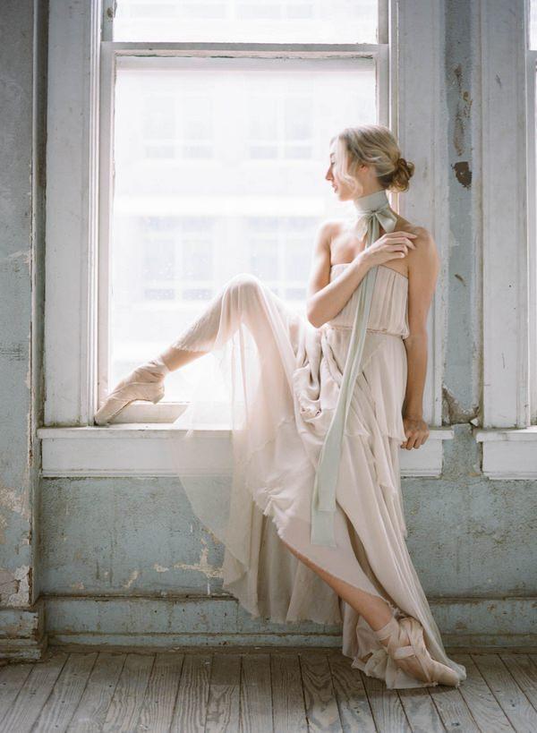 Ballerina bride sitting on window ledge