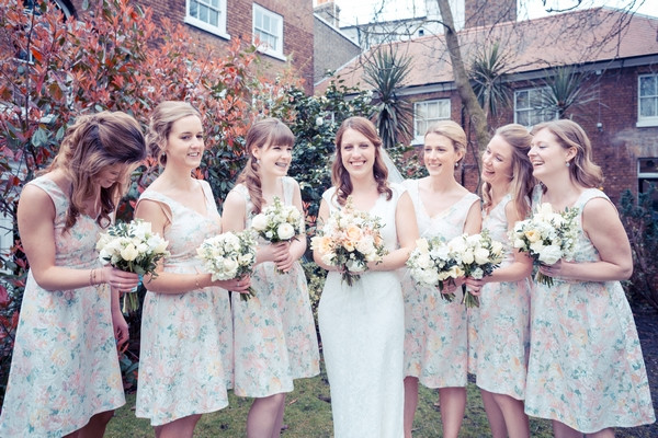 Bride and bridesmaids in floral dresses