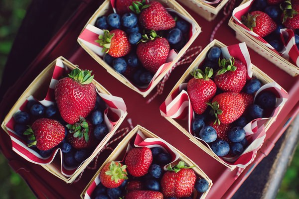 Punnets of blueberries and strawberries
