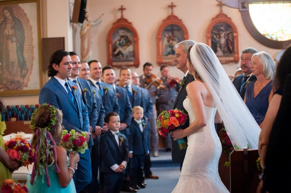 Father walking bride to groom at altar