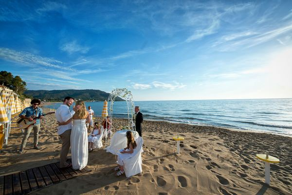Vow renewal on beach in Italy