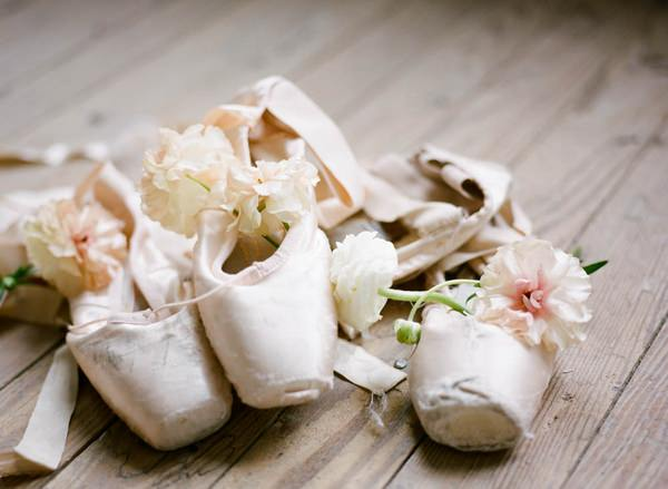 Ballerina shoes on floor with flowers
