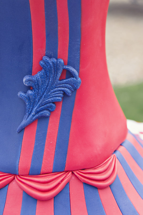 Blue and red detail on carnival wedding cake