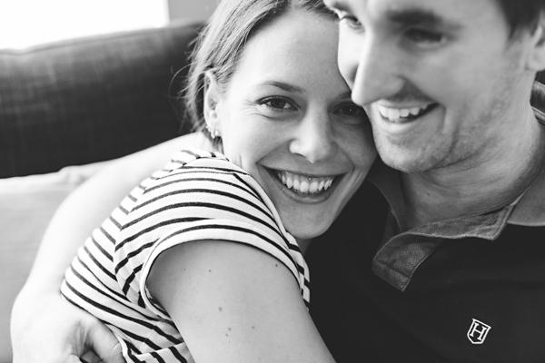 Engaged couple cuddling
