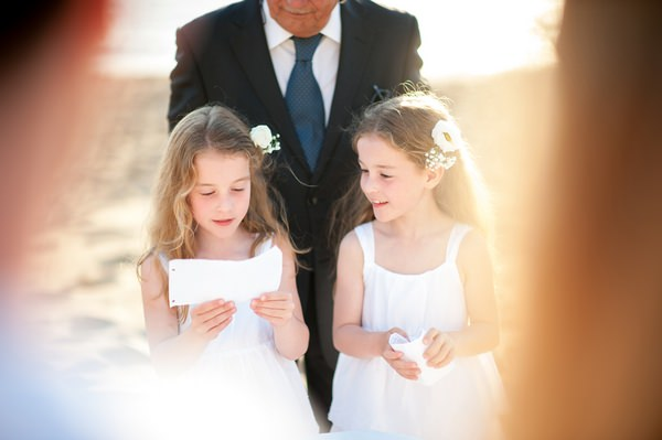 Young twin girls doing reading at vow renewal
