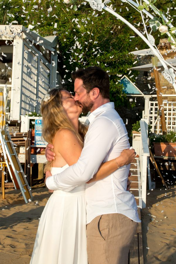 Couple kissing after renewing vows