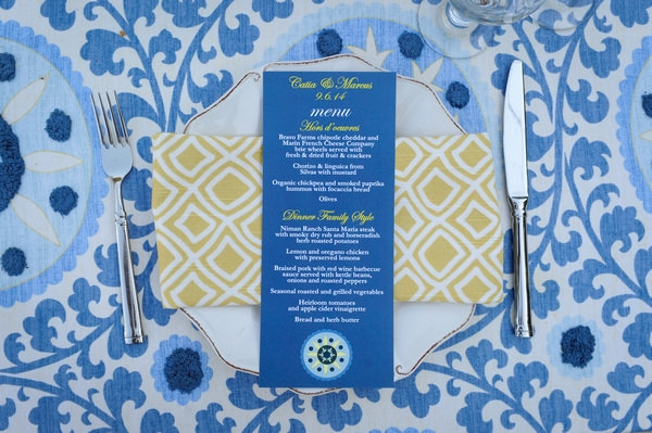 Blue and yellow wedding place setting