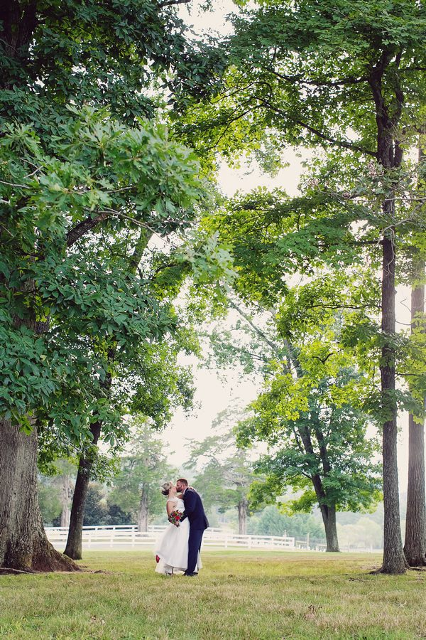 Bride and groom under trees at Keswick Vineyards