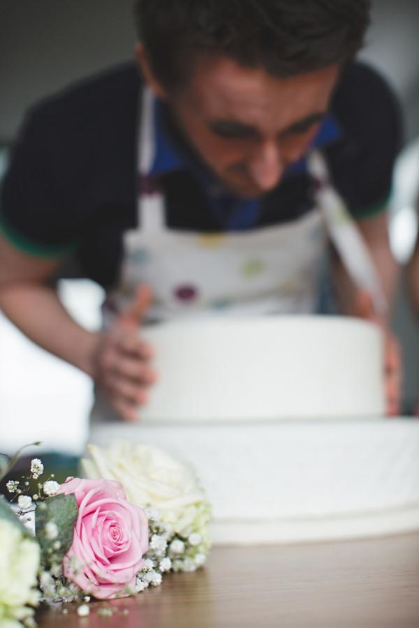Man icing cake