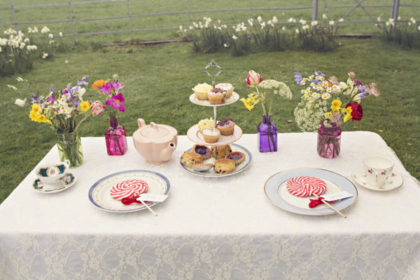 Table with cakes and lollipops