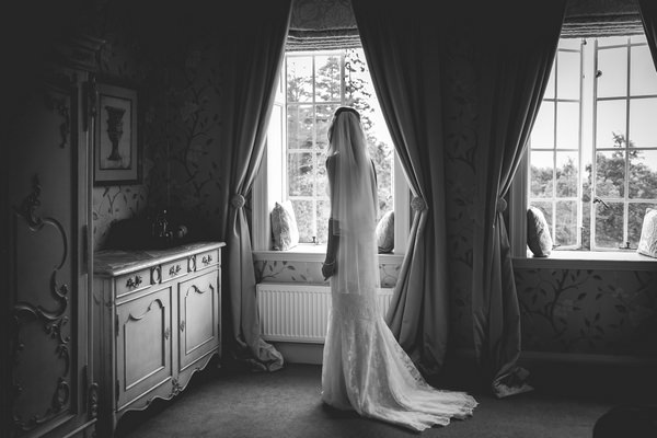 Bride standing by window - Picture by Andrew Keher Photography