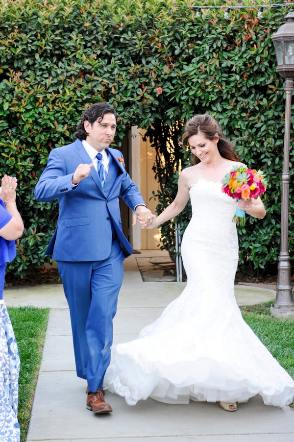 Bride and groom doing funny walk