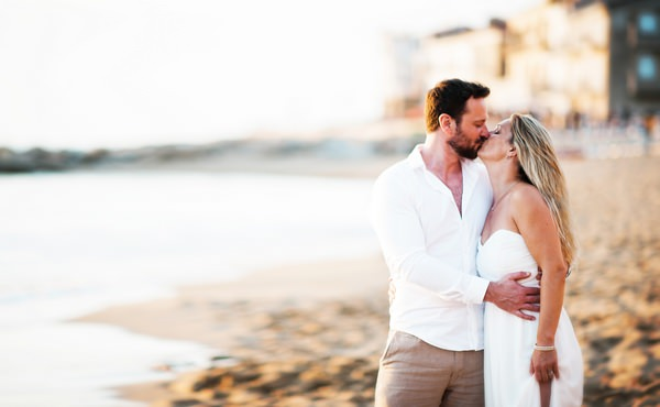 Couple kissing on beach in Italy