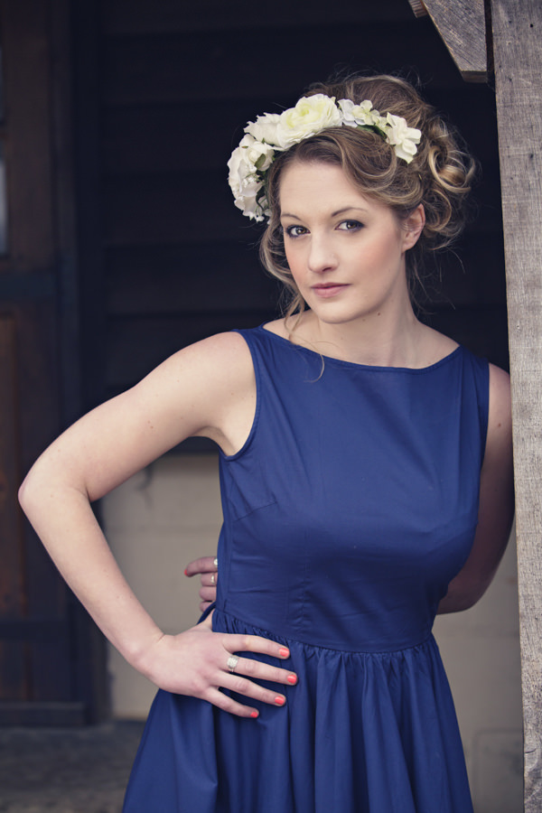 Bride wearing blue wedding dress and white flower crown