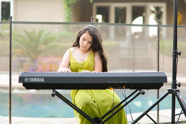 Young bridesmaid playing keyboard